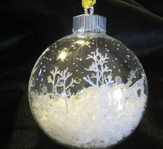 """Christmas ornament idea: clear glass ball, fill half with """"snow"""", paint snowflakes & trees with a white or silver paint pen. by rosalyn"""