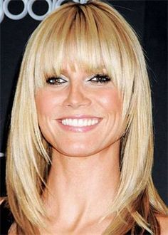 Long Bob or medium length with feathered layers framing the face with bangs…