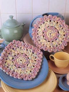 Spring Trivets  Easy to make, cute, and perfect for using as pot holders or heating pads!  Designed by Jennifer Christiansen McClain  free pdf from free-crochet.com