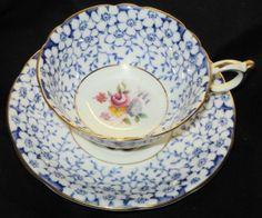 PARAGON FLOWER PETAL CHINTZ FLOW BLUE TEA CUP AND SAUCER