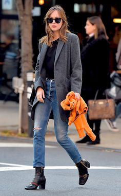 Dakota Johnson from The Big Picture: Today's Hot Pics  Ready for fall! The actresswas spotted wearing Gucci heels, ripped jeans and a grey coat while out and about in New York.