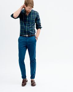 J.Crew men's vintage oxford shirt, 484 broken-in chino pants, Ludlow penny loafers, and classic leather with removable silver-plated buckle belt.