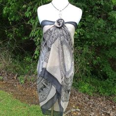 Black and Bone Print Sarong/Scarf Coverup This wrap will be excellent for the pool or beach. Lots of material to wear many ways. Perfect swimsuit cover up or a very fashionable look would be to wear a black halter top and make this a top over it wear as in the first three pictures shown above with a pair of ripped blue or black skinny jeans.  You could just use as a scarf this piece will be very functional in your wardrobe. To wear as shown above recommend size is small. The dimensions are…