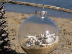 Beach Christmas ornaments.  I am going to save shells and sand from our next beach trip and then make an ornament for Christmas...with the date of our special trip.