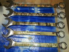 Assortment of camo hydro-dipped wrenches..
