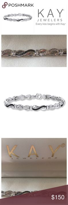 """Kay Jewelers B & W Diamond Infinity Bracelet OMG!! Truly Gorgeous! Worn once when received lol its so perfect for yourself or gift giving. The Black & White Diamond Infinity Bracelet from Kay Jewelers. Round diamonds in prong settings. 7.5"""" bracelet, Sterling silver stamped 925, with lobster clasp closure. Just beautiful 💗 Reasonable Offers Welcome through button.-reduced from 150 already. 😱 Kay Jewelers Jewelry Bracelets"""