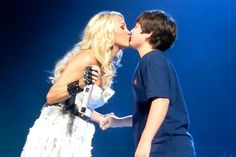 Carrie Underwood gives a 12-year-old boy his first kiss. This pisses me off. Imagine a 29 year old guy kissing a 12 year old girl on stage!