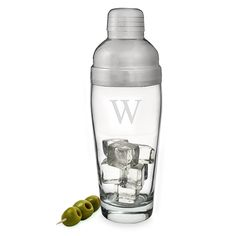 A glass cocktail shaker with his initial engraved front and center