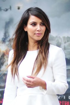 """If you're already a brunette but want a deeper version, go for a look like Kim Kardashian's. Just be careful not to get too dark, since it might look unnatural (aka stay away from terms like """"black,"""" """"blue/black,"""" and """"brown/black"""" on drugstore dye kits).  Look for terms like """"deep brown"""" and """"rich brown"""" on at-home box kits."""