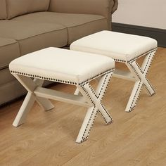 @Overstock.com - Zoey Crossed Legs Bone White Ottoman (Set of 2) - With stud trim and crossed legs, this ottoman set will add a contemporary touch to any room. These ottomans are finished with faux leather upholstery.  http://www.overstock.com/Home-Garden/Zoey-Crossed-Legs-Bone-White-Ottoman-Set-of-2/7109796/product.html?CID=214117 $202.99