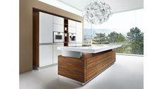 Die k7 Küche von TEAM 7 eignet sich optimal für offene Lebensräume aus Küche, Esszimmer und Wohnzimmer.