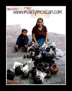 Grand Master potter, Elena Felipe of Zamora, Michoacan packs up her work & family to bus out of state to try to sell her work on the streets of towns with more tourists.  We purchased most of what is seen here.  For more see on line store www.mainlymexican.com #Mexico #Mexican #vintage #antique #folkart #collectible #art #ceramic #clay #artisan #Feria Maestros