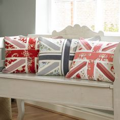 vintage linen union jack cushion collection on painted bench