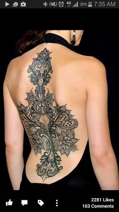 Women's back tattoo