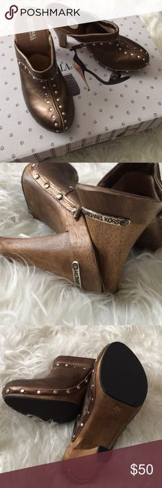 Michael Kors leather clog. NEW! This is golden leather clog by Michael Kors, perfect for party or gathering, will make you beautiful with your dress. It is 5 inch. Heel. Michael Kors Shoes Mules & Clogs