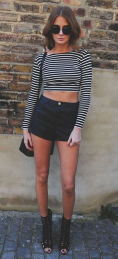 Millie Mackintosh Is Wearing A Striped Crop Top And Shoes From River Island, Paired Up With A Black Shorts From Topshop, The Bag Is From Asp...