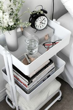 Use a rolling cart for a creative and practical bedside table. Very inexpensive but it's so pretty when styled with all of your favorite things.