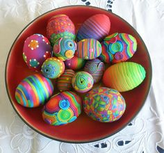 Empty real eggs, wooden egs, ceramic egg shaped beads, coated with polymer clay