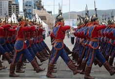 Guardsmen of the Mongolian Army guard of honor marching through Sukhbaatar Square in Ulaanbaatar at the 2014 Mongolian Flag Day Parade.