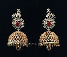 Grand classic diamond jhumkas with a lovely bell shaped jhumka hanging with a diamond studded ball in the middle. The diamond jhumkas are headed with a peacock design Diamond Pendant Necklace, Diamond Jewelry, Gold Jewelry, Jewelery, Diamond Necklaces, Diamond Earrings, Gold Necklaces, Gold Bangles, Diamond Jumkas