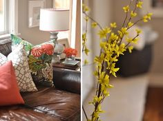 Pillows on a brown leather couch (and some forsythia to boot)