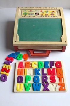 Cute educational toy with magnetic letters, chalk board, etc.
