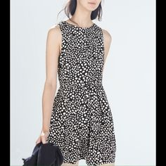 """Black and white Zara party dress NWOT. Adorable party dress from Zara. Black and white print. Gathered at the stomach with a non-adjustable tie. It even has pockets! I am 5'1"""" and it hits right at the knees. Zara Dresses Mini"""