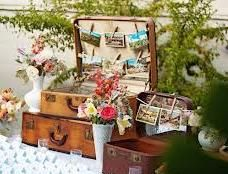 Was your loved one a world traveler? How about a travel themed memory table? Add photos from their trips, maps and passport. Vintage luggage is a great place to display travel keepsakes and adds height. #funeral ideas, #memorial ideas, #funeral memory table, #memory table, #life celebration ideas