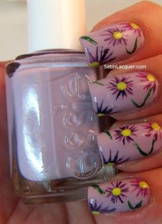 Easy purple flower nail art design using Essie Clambake (pale lavender) as base color. Flower details done with nail art brush, dotting tool & striping polish for vines.:
