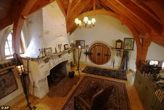 """This real-life hobbit house in Chester County, PA, """"belongs to a lifelong fan of J.R.R. Tolkien...Inside the small dwelling are curved arches and rafters of Douglas fir, a fireplace finished in stucco and accented with thin slices of clay tile, and plenty of shelves and ledges for the owner's library and displays of Hobbit figurines, Gandalf's staff, hooded capes, chess sets, chalices - and of course, The One Ring."""" [7th of 8 pins]"""