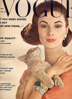 Wilhelmina in a wool crepe dress by Hannah Troy and jewelry by David Webb, cover by Karen Radkai, Jan. 1962