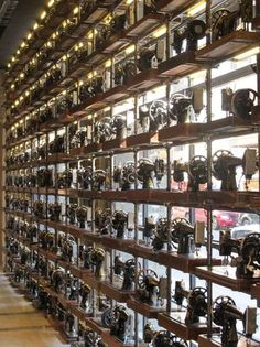 Wall of antique sewing machines