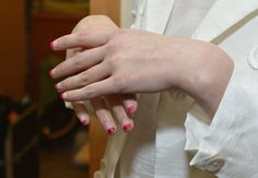 JSong: Pale pink and red polish were colour-blocked to create a simple yet graphic nail design at JSong's Fall 2013 showing.