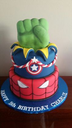 Superhero themed cake. Spiderman, captain America complete with handmade hulk fist. By Toppers cakes and cupcakes.