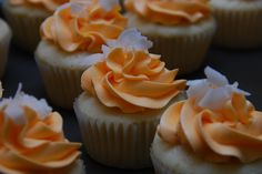 coconut cupcake with passionfruit curd filling and passion fruit italian meringue buttercream via A Cup Full of Cake
