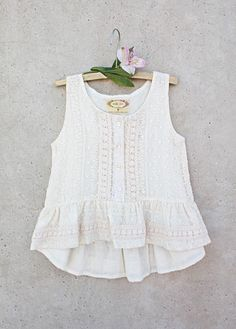 With beautiful embroidered detailing, this cute cream top features a ruffled hem and a subtle high low style.