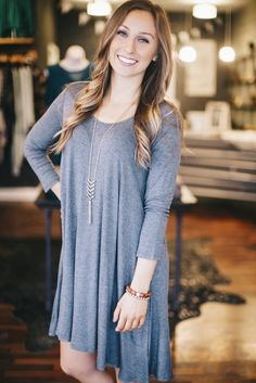 This breezy tunic has us swooning! We love the lace up details and basic color. Wear it as a dress or pair it with leggings for the perfect outfit! Hannah is shown wearing a small. *Fits true to size