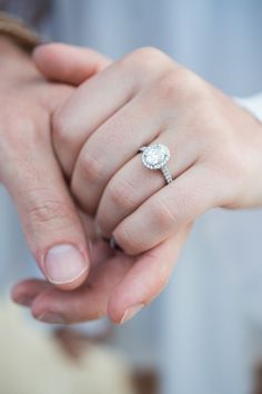 This oval halo engagement ring is such a beauty.