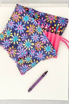 Let their creativity sore with this crayon roll!| Pockets for 24 crayons in a stylish floral pattern in hot pink, purple and yellow| Keep little hands busy while you get your to-do list done! Birthday Gifts For Girls, Girl Birthday, Cool Patterns, Fabric Patterns, Colored Pencil Holder, Twistable Crayons, Pink Purple, Hot Pink, Crayon Roll