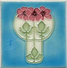 Art Nouveau-style tile, pretty pink flowers x 3, turquoise blue background, light green stem, and white.