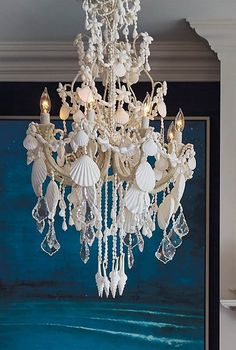 An ethereal symphony of cascading crystals and seashells, our Harbor Shell Chandelier casts a captivating note in any space. The exclusive, all-white fixture features a [. Seaside Decor, Beach House Decor, Coastal Decor, Home Decor, Seashell Chandelier, Chandelier Lighting, Chandeliers, Antique Chandelier, Wooden Decks