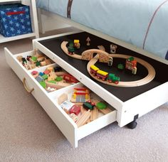 This as a lego table. It's a drawer with a top and casters. Could be pushed under bed once done playing
