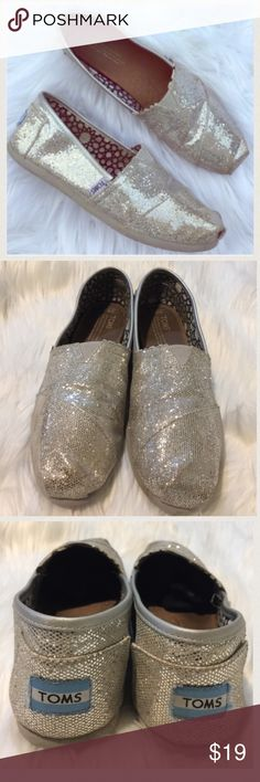 TOMS silver glitter shoes Gently worn , no rips or holes , size 8.5, some glitter rubbed off but not noticeable TOMS Shoes