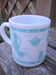 Vintage white and blue PYREX mug by carouselandfolk on Etsy, $5.00      My daughter bought me one. I love it!!!