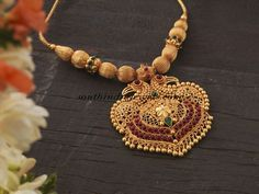 Beautiful temple jewellery gold necklace in light weight gold balls design paired with gandaberunda pendant which is a twin peacock design pendant Gold Jhumka Earrings, Gold Earrings Designs, Gold Jewellery Design, Gold Pendant Necklace, Necklace Designs, Gold Designs, Gold Pendent, Designer Jewelry, Pendant Jewelry
