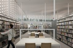 All of the bookshelves are free-standing and placed away from the perforated wall.