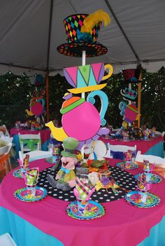 Wonderland theme table centerpiece by : WONDERLAND PARTY PROPS. see us on Facebook for party prop rental and decorating services.