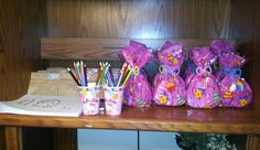 Hello Kitty Birthday - Party favors with each a birthday coloring book design for the party. Goody bags had all kinds of knick knacks on top of finding actual Chocolate candies by Hello Kitty!