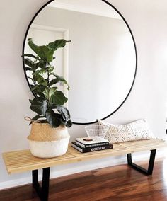 Minimal entryway decor with a large round mirror with gold frame - Decoist Decoration Hall, Decoration Entree, Hall Way Decor, House Decorations, Home Interior, Interior Decorating, Interior Design, Bohemian Interior, Interior Styling