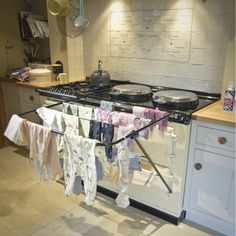 We love this Aga drying rail from Betty Twyford.  http://www.periodideas.com/large-aga-drying-rail-from-betty-twyford